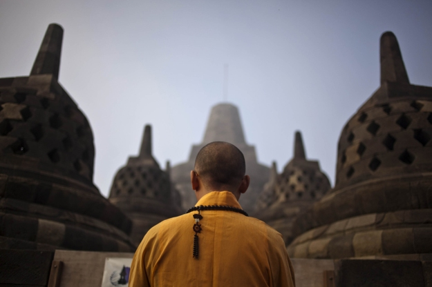 A Buddhist monk prays at Borobudur temple on Vesak Day at the Borobudur Mahayana Buddhist monument. Picture by Ulet Ifansasti.