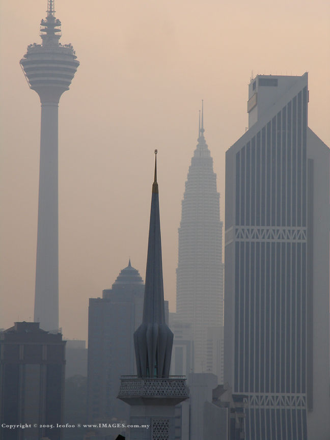 The hazy scene of KL Tower & Menara Maybank with the Petronas Twin Tower at the background.