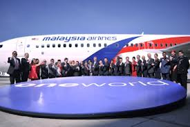 Thank God the management didn't use the new A380 with the funeral blue logo as its background for the recently launch MAS joining the OneWorld.