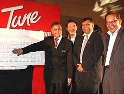 2nd right in picture: YM Tengku Aziz when he was the CEO of Tune Money, a company related to the AirAAsia outfit, (after the then Minister of Finance II Tan Sri Nor Mohamad Yakop)