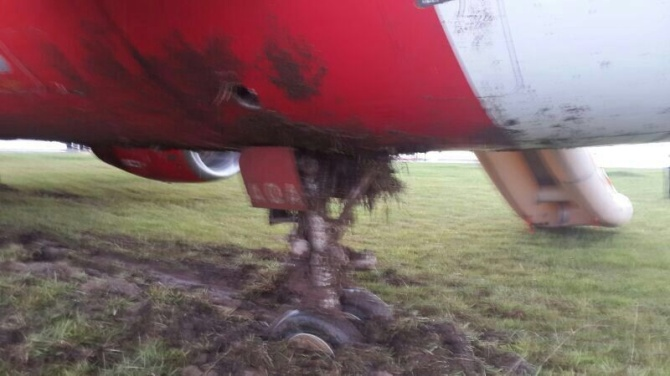 AirAsia wheel in the mud.